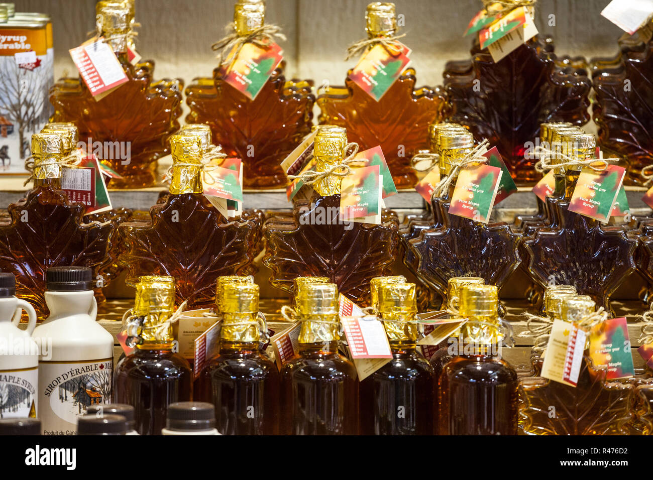 MONTREAL, CANADA - NOVEMBER 3, 2018: Maple Syrup bottles for sale on Montreal Jean Talon market. Quebec is the highest producer of Maple syrup in the  - Stock Image