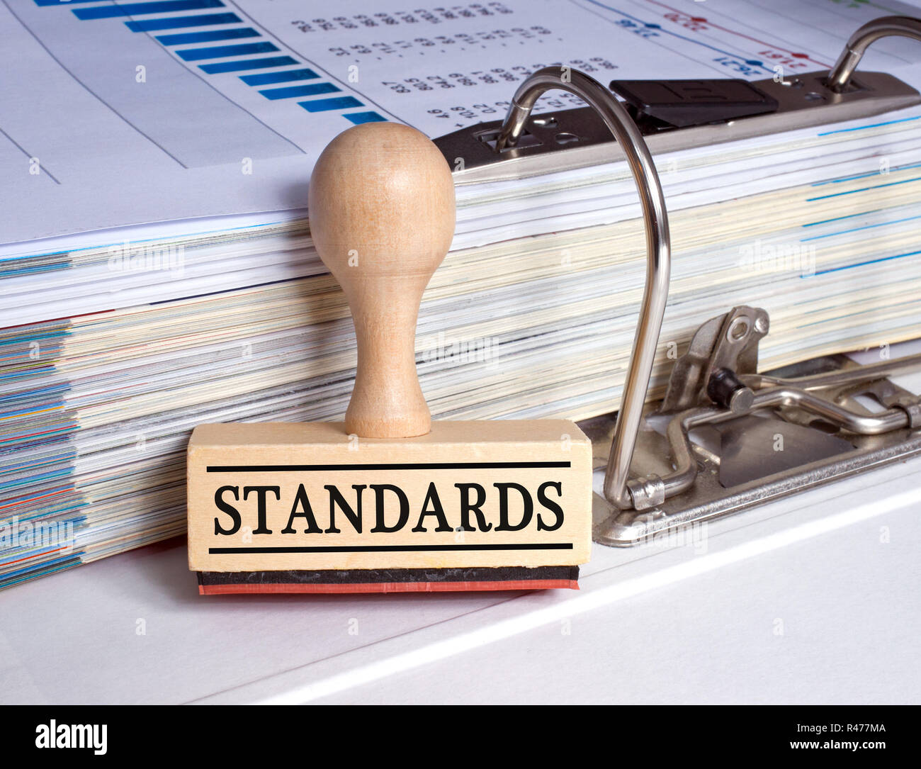 Standards stamp with binder in the office - Stock Image