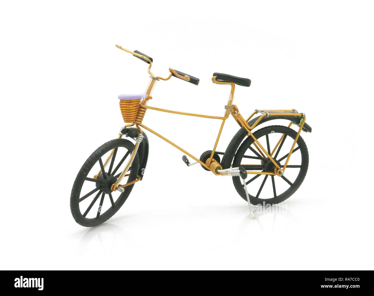 vintage gold bicycle model for decoration - Stock Image