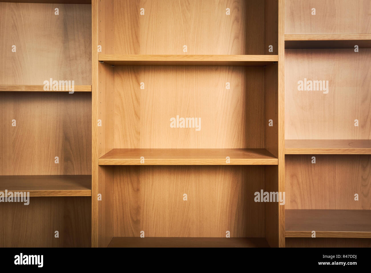 Empty wooden book shelves background. - Stock Image