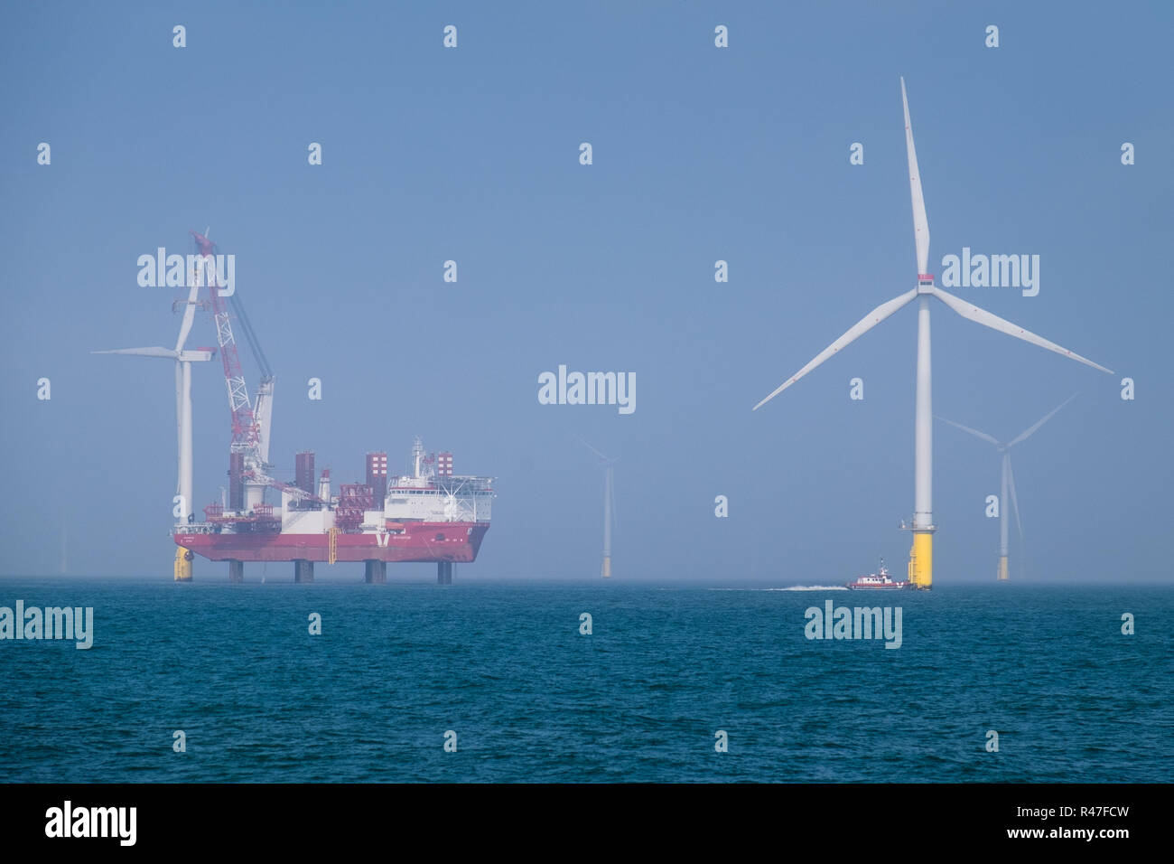 MPI Adventure conducting turbine blade upgrade work on London Array Offshore Wind Farm off the north coast of Kent - Stock Image