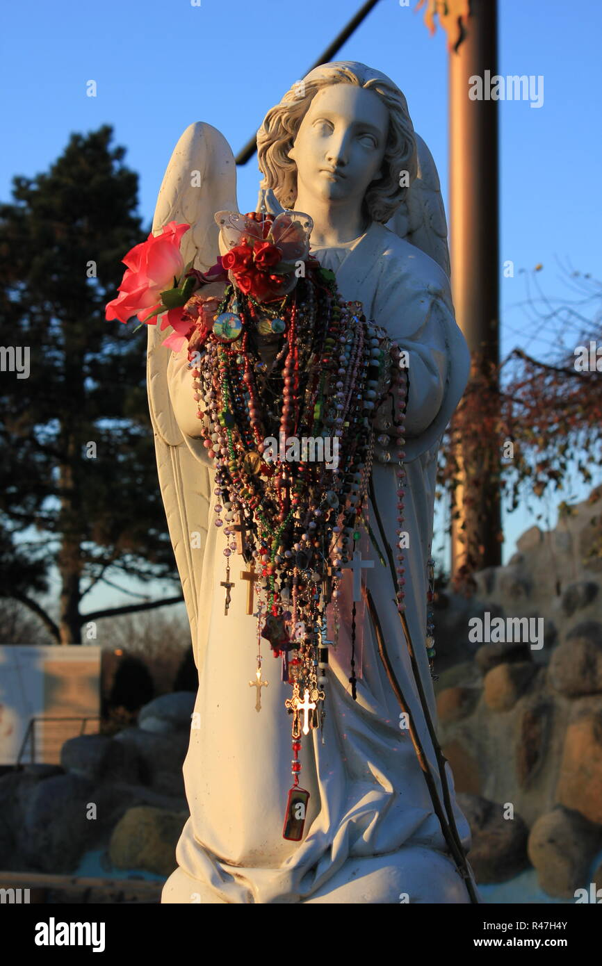 Angels holding armfuls of rosaries left as mementos of private requests at Our Lady of Guadalupe Shrine, frequented by Hispanics and immigrants, located in Des Plaines, Illinois. Stock Photo