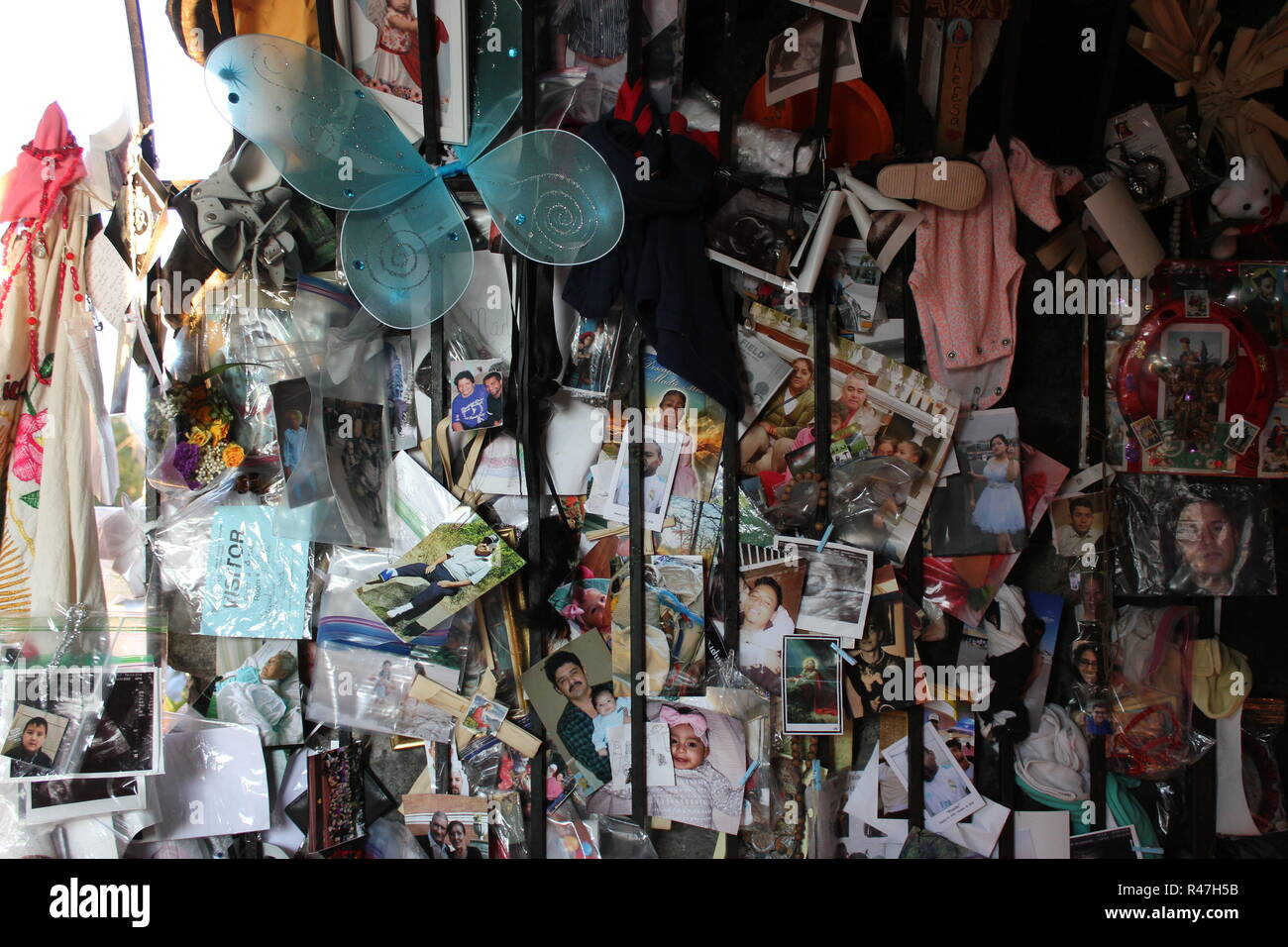 Private belongings, pictures, photos, memories left as a request at Our Lady of Guadalupe Shrine, frequented by Hispanics and immigrants, located in Des Plaines, Illinois. - Stock Image