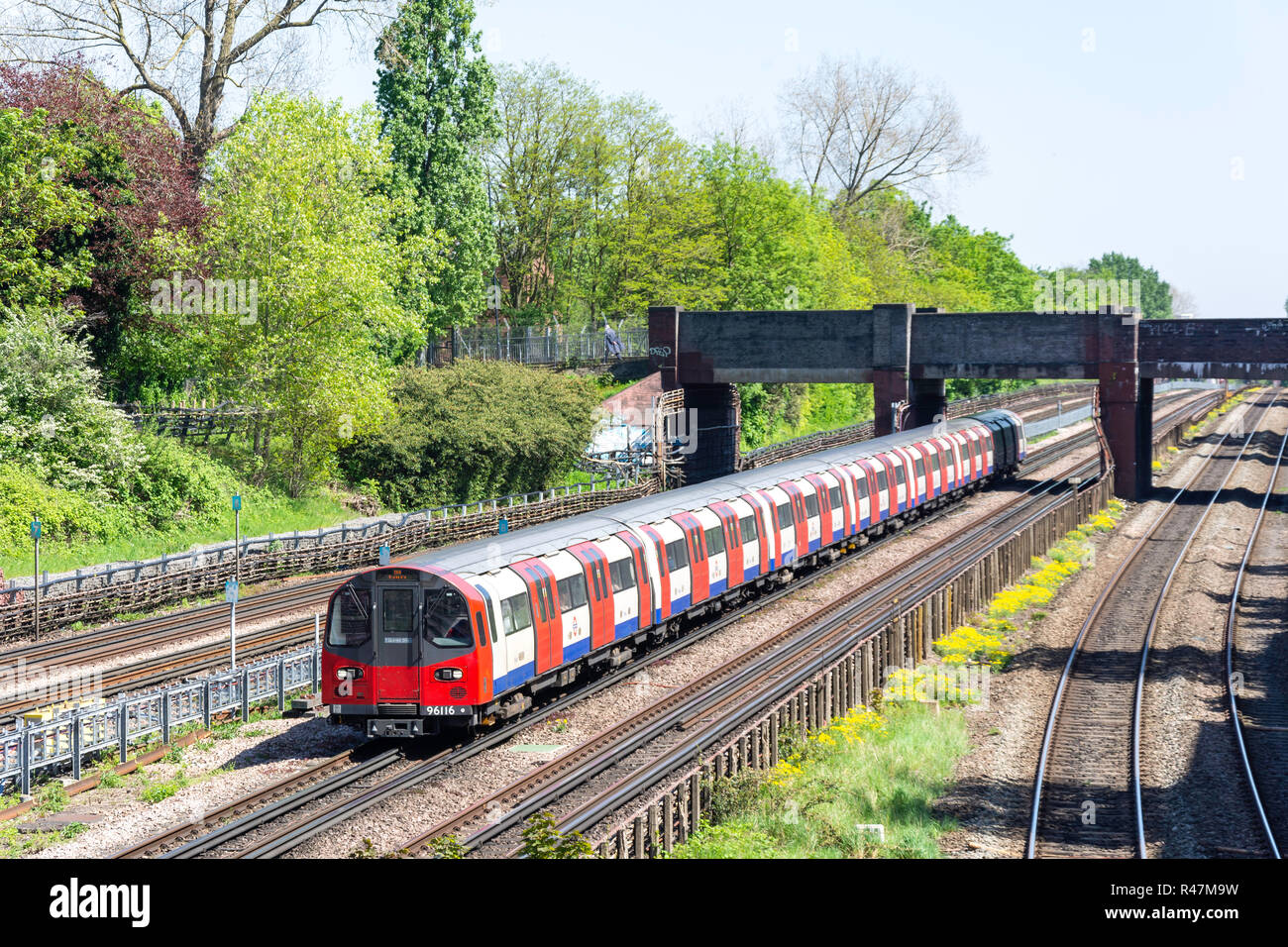 Train approaching Willesden Green Underground Station, Willesden, London Borough of Brent, Greater London, England, United Kingdom - Stock Image