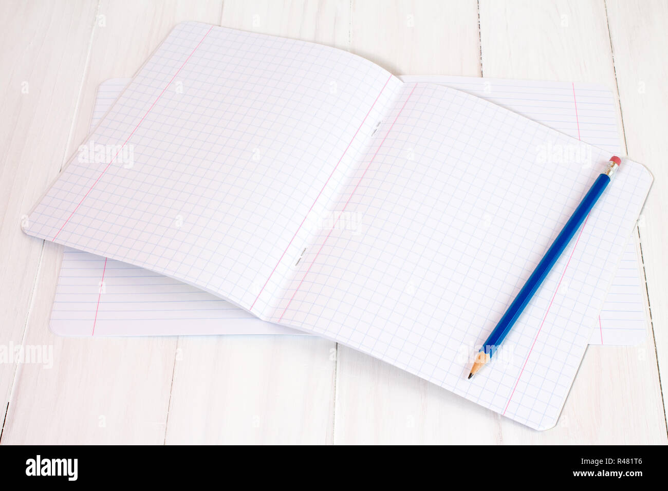 New exercise books and pencil Stock Photo: 226370486 - Alamy