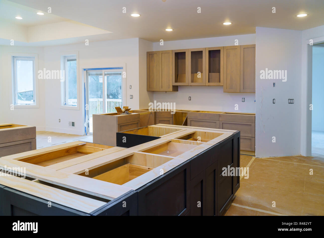 Installing New Induction Kitchen Kitchen Installation Of Kitchen Cabinet Stock Photo Alamy
