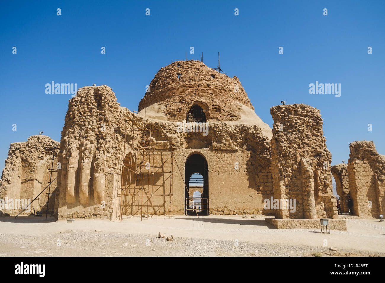 Sarvestan Palace is a Sassanid-era building, was built in the 5th century AD. The building made of baked brick, stone and mortar.  Sarvestan, Iran. - Stock Image