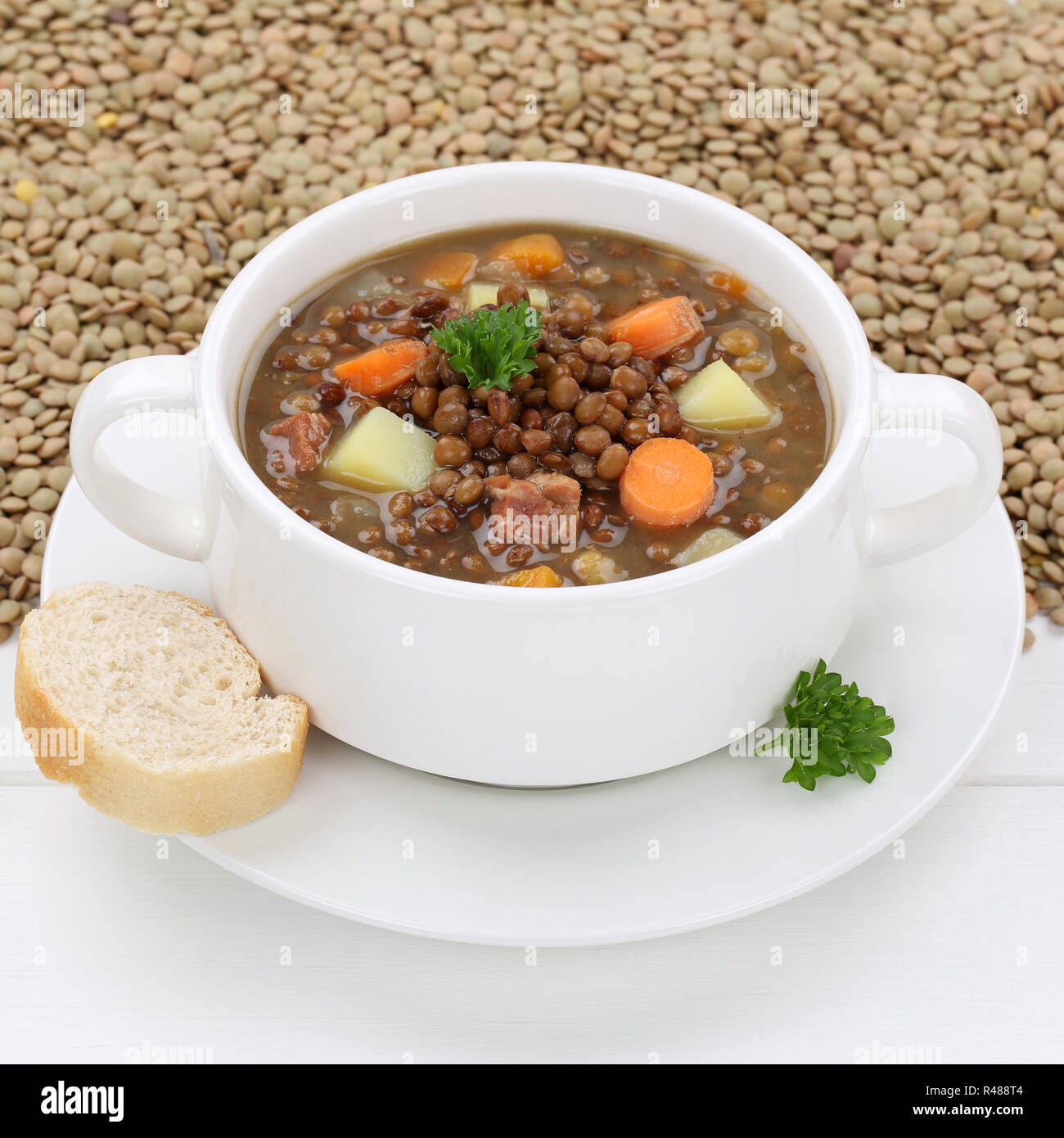 healthy eating lentil soup with fresh lentils soup in soup bowl Stock Photo