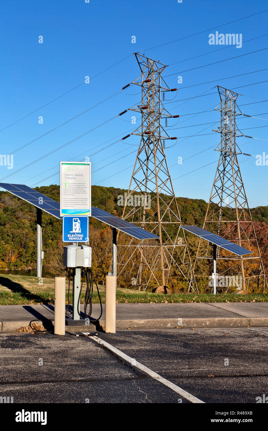 Electric Vehicle Charge Station, solar panels, electric Transmission Towers,  overlooking Clinch River, Melton Hill Hydro Electric Dam. Stock Photo