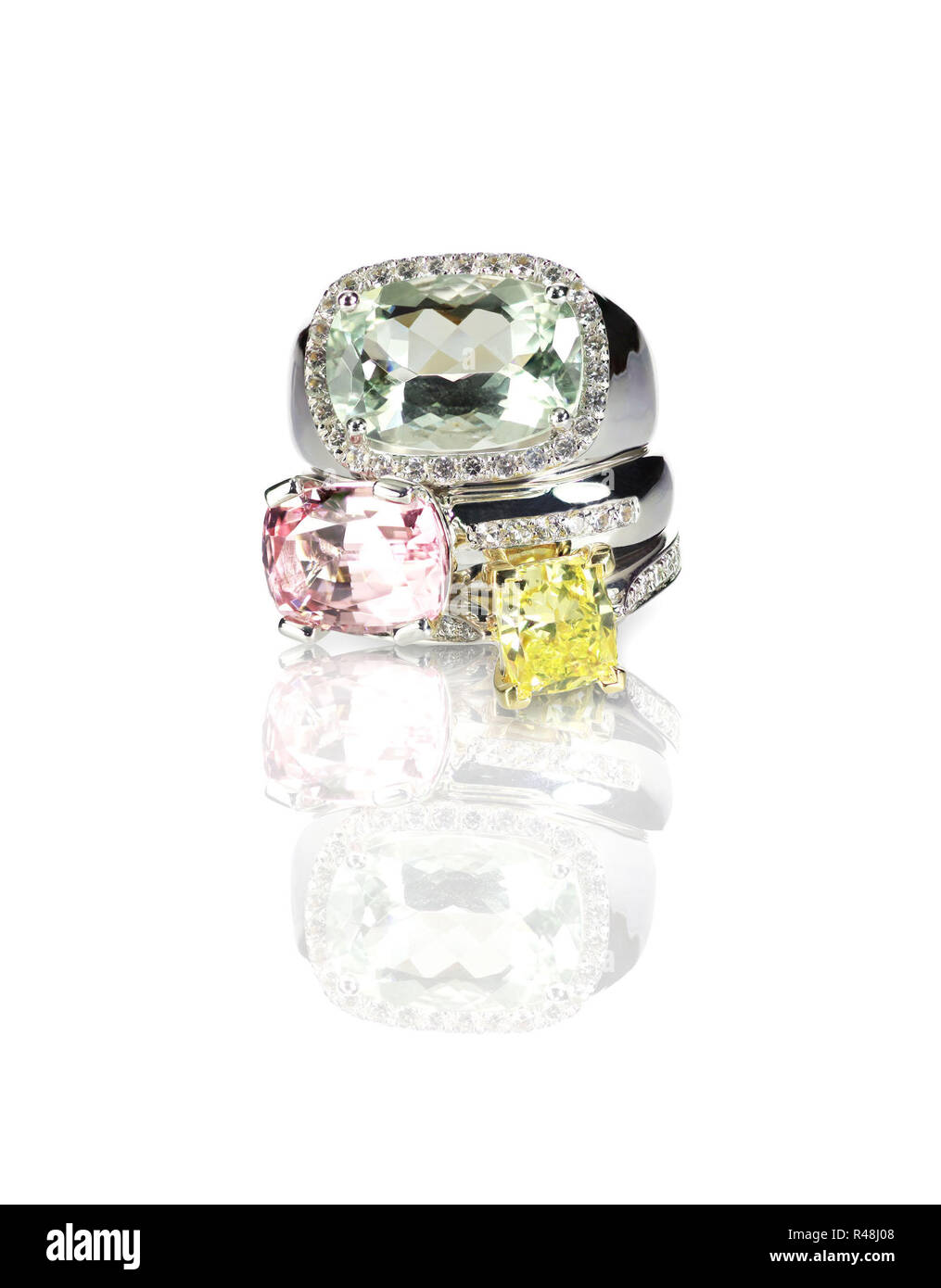 Grouping of colored gemstone diamond rings stacked - Stock Image