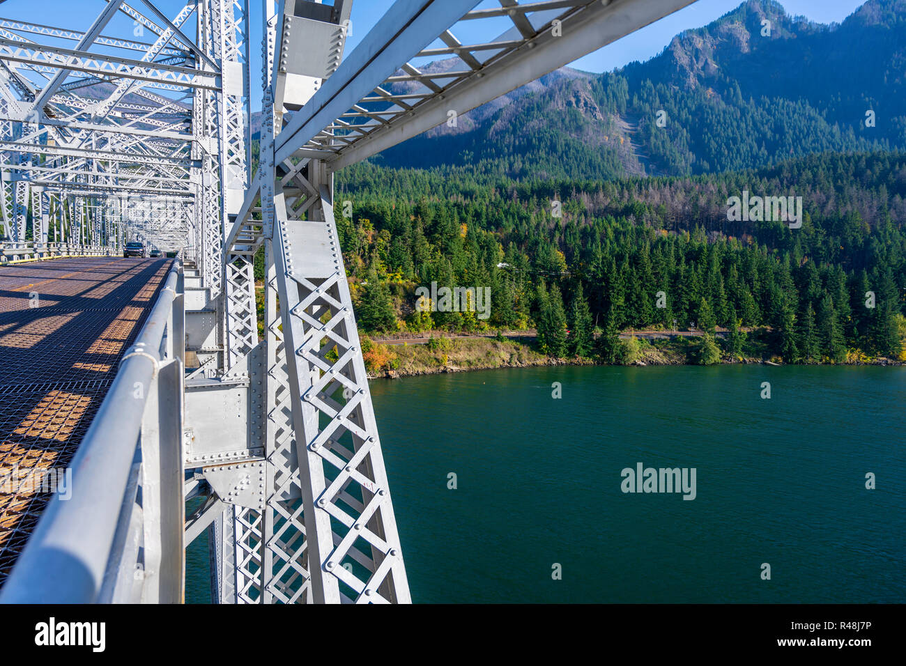 The truss Bridge of God over the Columbia River is located in a picturesque area of Columbia Gorge with hills and rocky mountains forest covered - an  Stock Photo