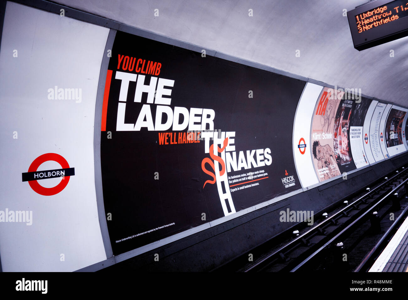48 sheet billboard Advertising poster next to the tracks on the London Underground track - Stock Image