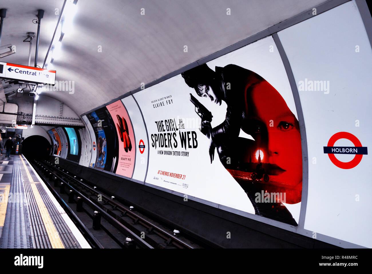 48 sheet billboard Advertising new film next to tracks on the London Underground underground track - Stock Image