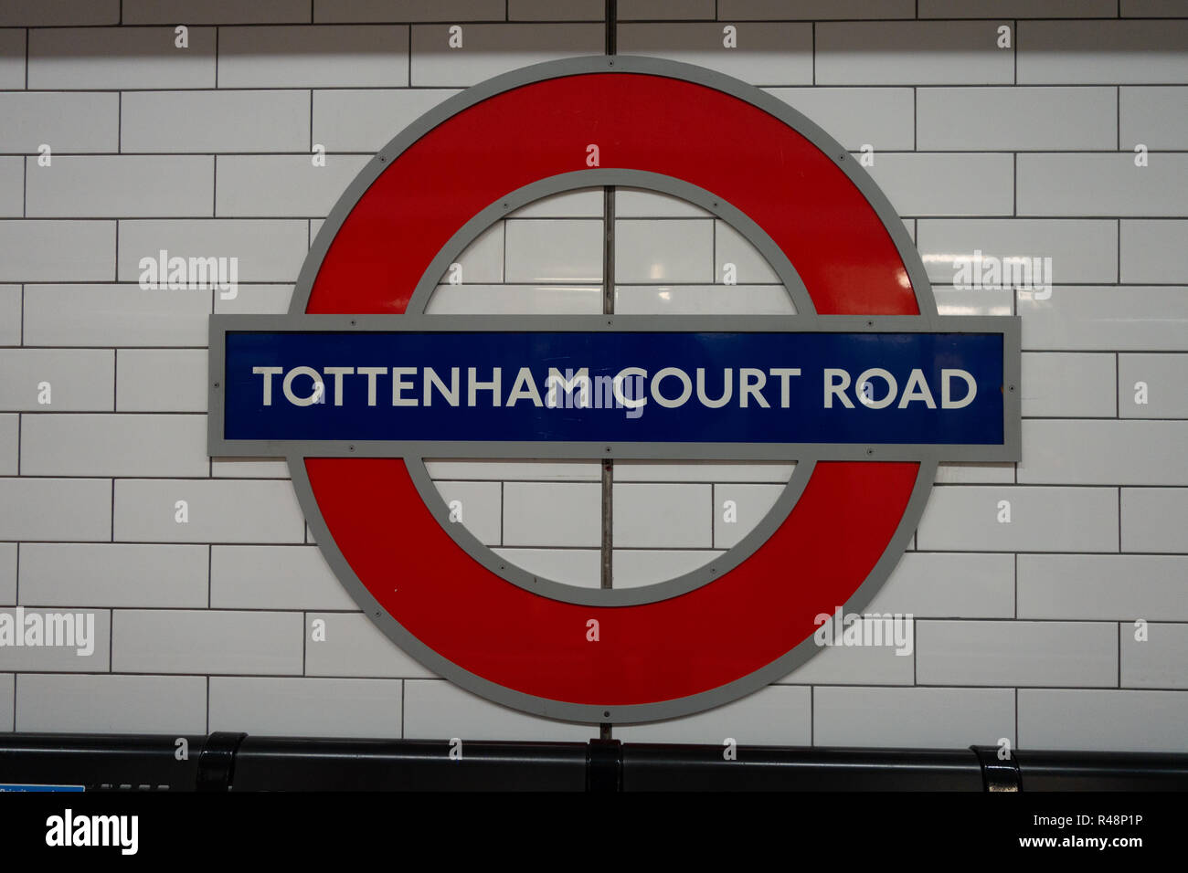 Tottenham Court Road London Iconic Underground Tube Logo sign - Stock Image