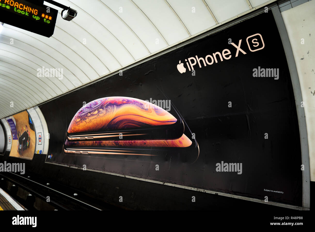 Ad poster for the new Apple iPhone XS, in the London Underground - Stock Image
