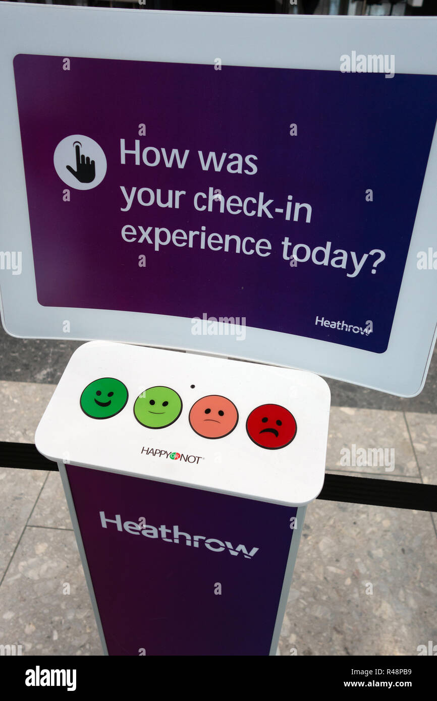 Happy or Not voting for service buttons at Check-in at Heathrow Airport International Airport in London, United Kingdom. Stock Photo