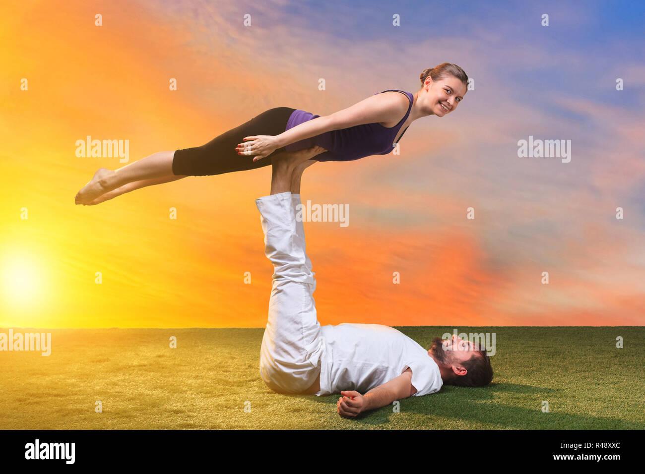 The Two People Doing Yoga Exercises Stock Photo Alamy