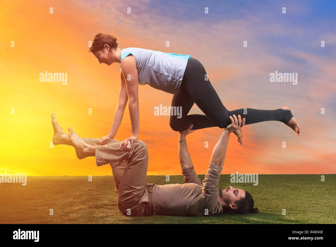 The Two People Doing Yoga Exercises Stock Photo Alamy