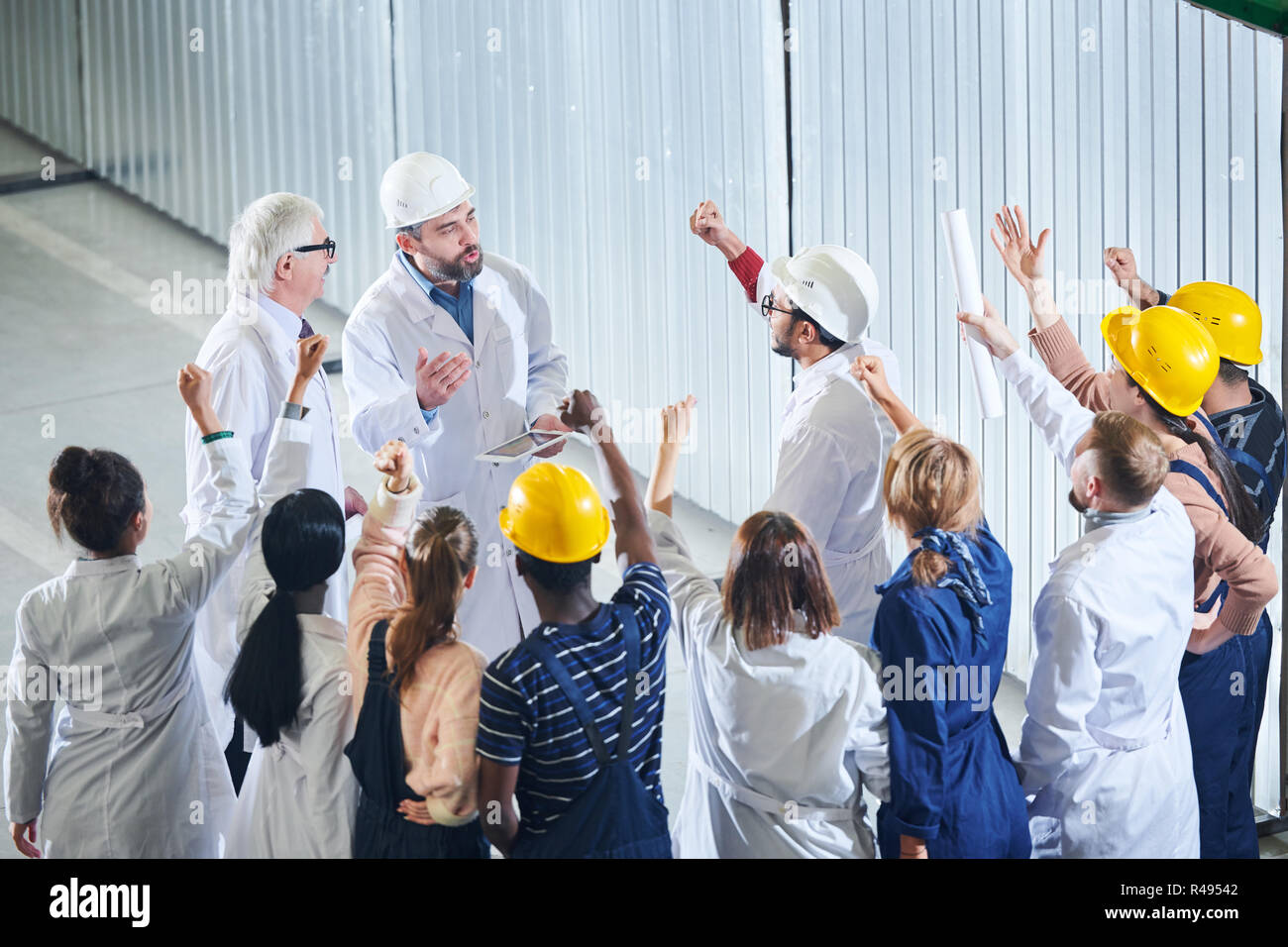 Angry Factory Workers Meeting with Management - Stock Image
