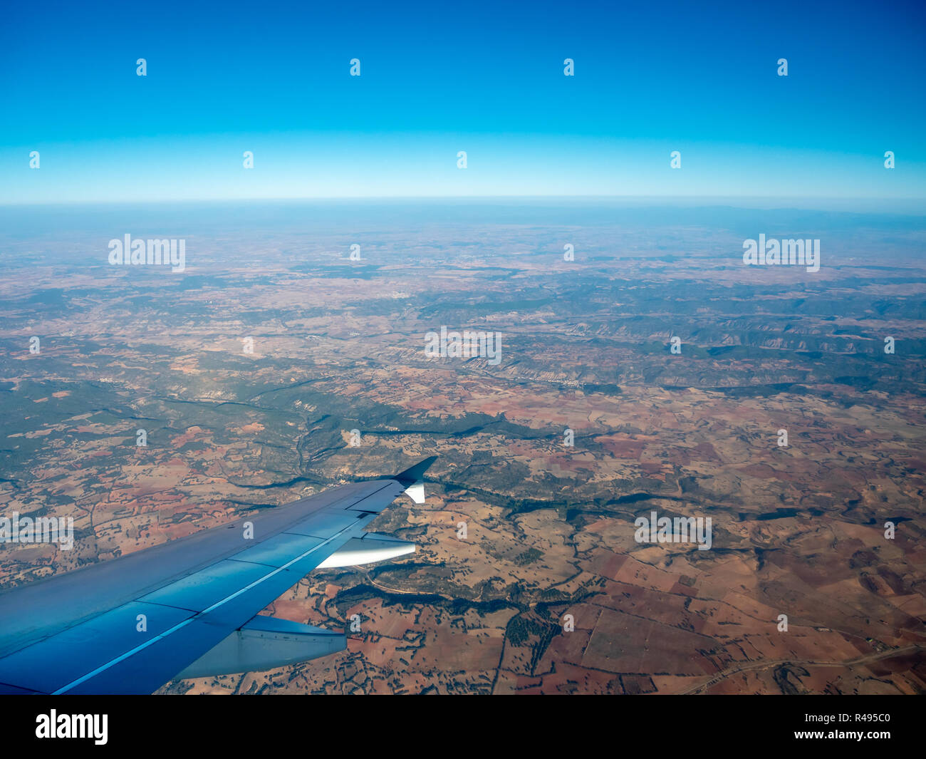 Aerial View of Mountain Formation Outside of Madrid Looking Out of Plane Making a Right Turn - Stock Image