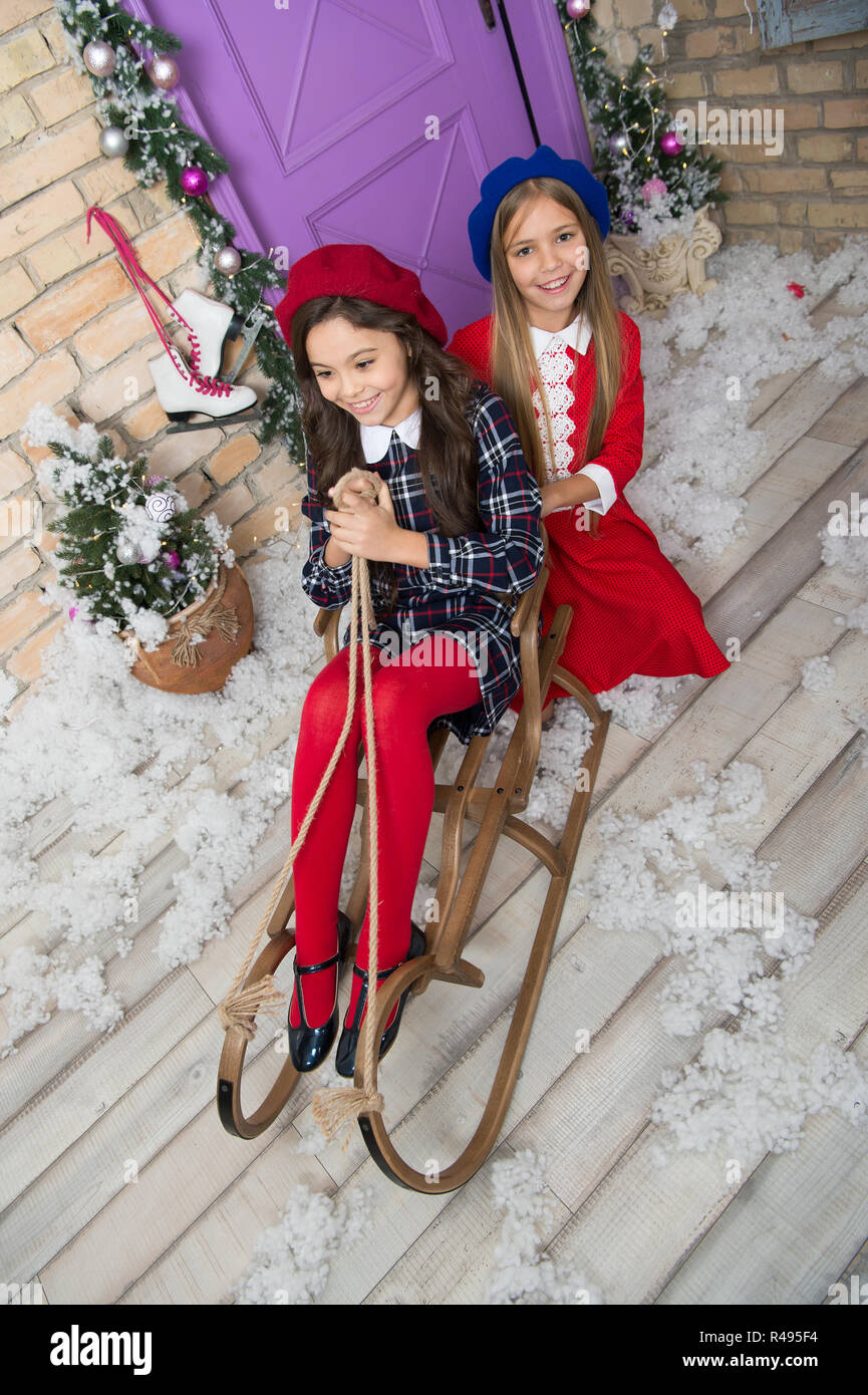 Happy new year. Winter. Christmas tree and presents. xmas online shopping. Family holiday. The morning before Xmas. Little girls on sleigh. Child enjo Stock Photo
