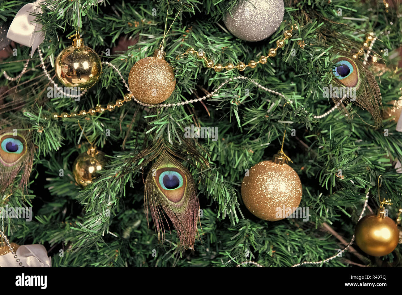 Christmas Tree With Baubles Peacock Feather Garlands On