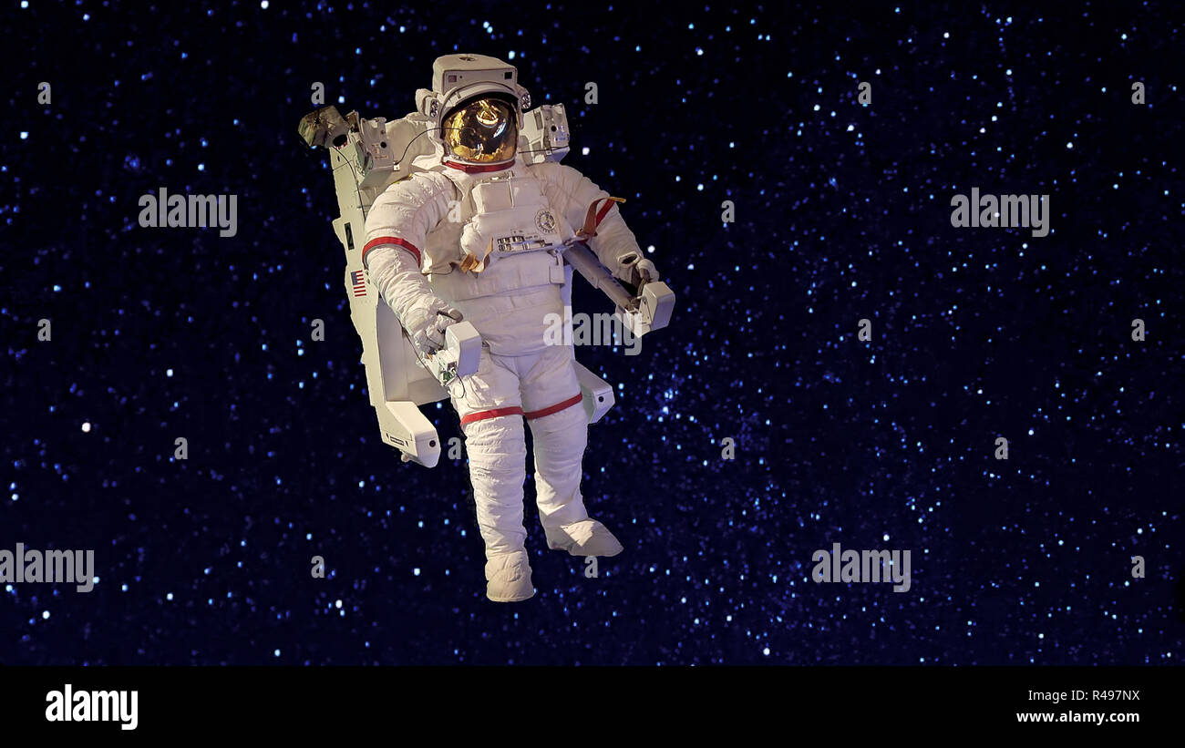 An astronaut in spacesuit floating in the blackness of space against a background of stars - Stock Image