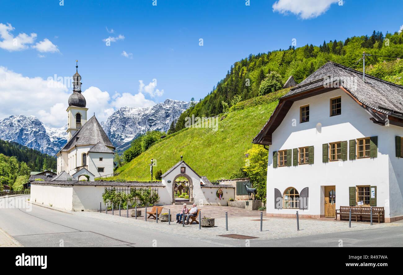 Scenic mountain landscape in the Bavarian Alps with famous Parish Church of St. Sebastian in the village of Ramsau, Nationalpark Berchtesgadener Land, Stock Photo