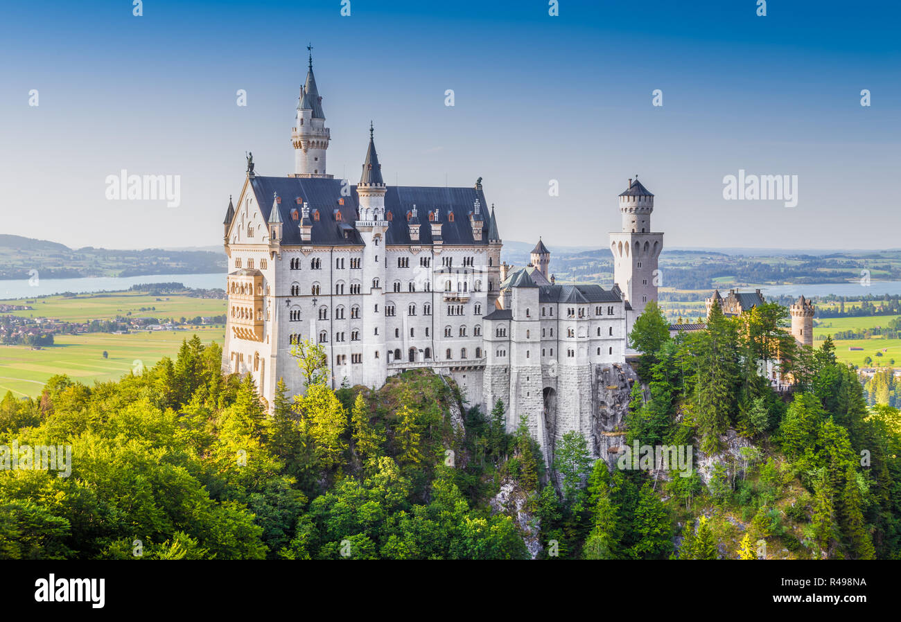 Beautiful view of world-famous Neuschwanstein Castle, the 19th century Romanesque Revival palace built for King Ludwig II, in beautiful evening light  - Stock Image