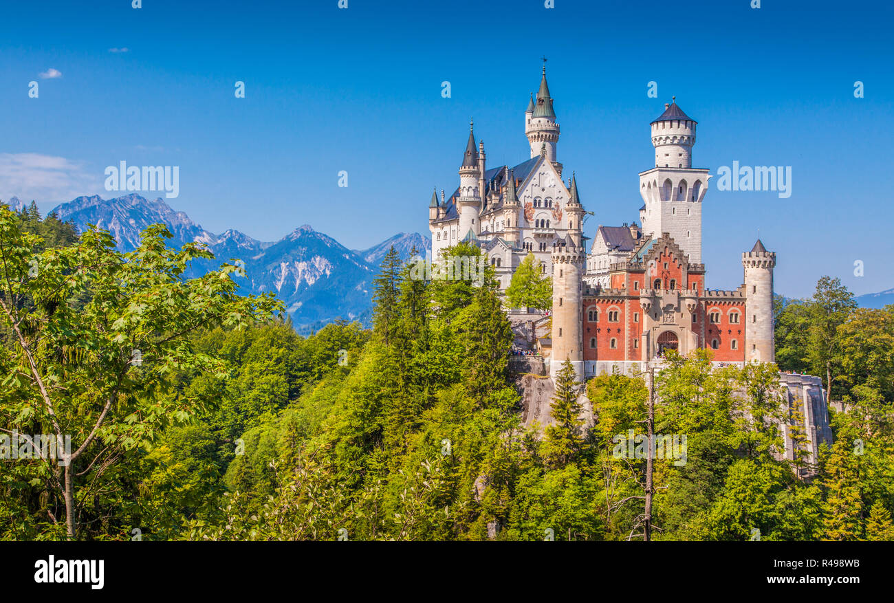 Beautiful view of world-famous Neuschwanstein Castle, the nineteenth-century Romanesque Revival palace built for King Ludwig II on a rugged cliff, wit - Stock Image