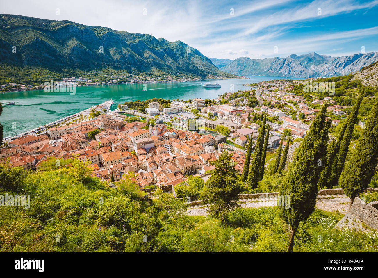 Scenic panoramic view of the historic town of Kotor with famous Bay of Kotor on a beautiful sunny day with blue sky and clouds, Montenegro, Balkans Stock Photo