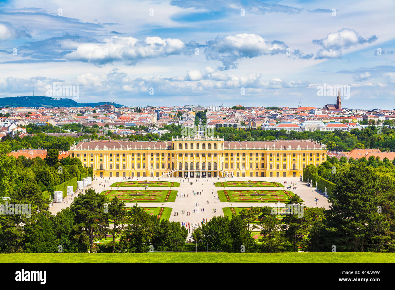Classic view of famous Schonbrunn Palace with scenic Great Parterre garden on a beautiful sunny day with blue sky and clouds in summer, Vienna, Austri - Stock Image