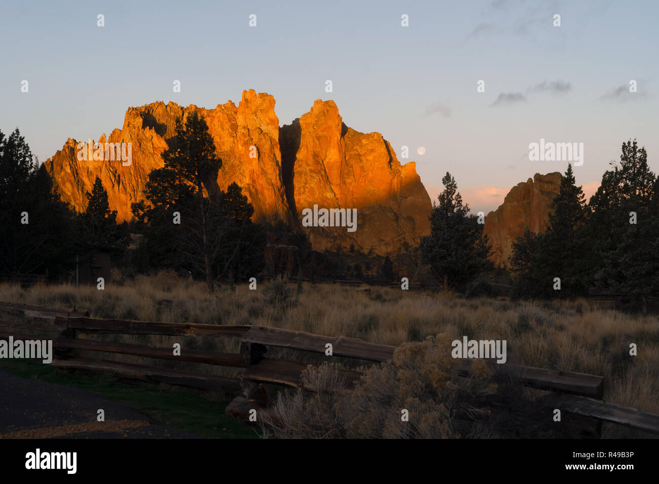 The Moon Sets as Sun Rises on Smith Rock Oregon Stock Photo
