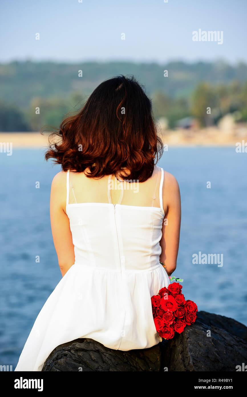 Woman dress white beside beach - Stock Image
