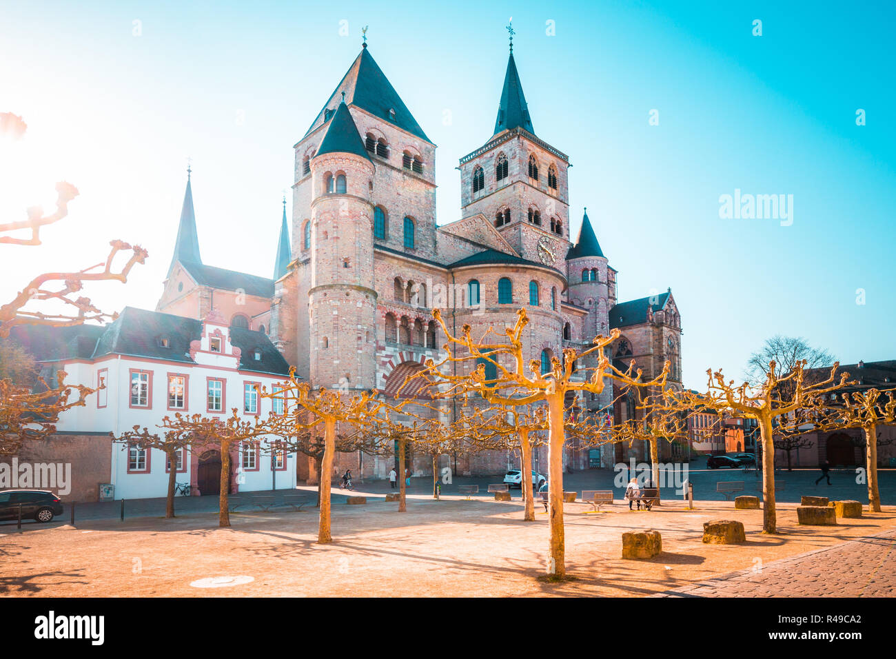 Beautiful view of famous Trierer Dom (High Cathedral of Trier) in beautiful golden morning light in summer, Trier, Germany Stock Photo
