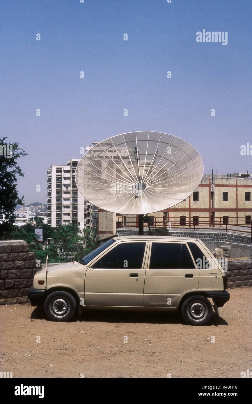 Maruti car parked besides dish antenna, Hyderabad, Andhra Pradesh, India, Asia - Stock Image
