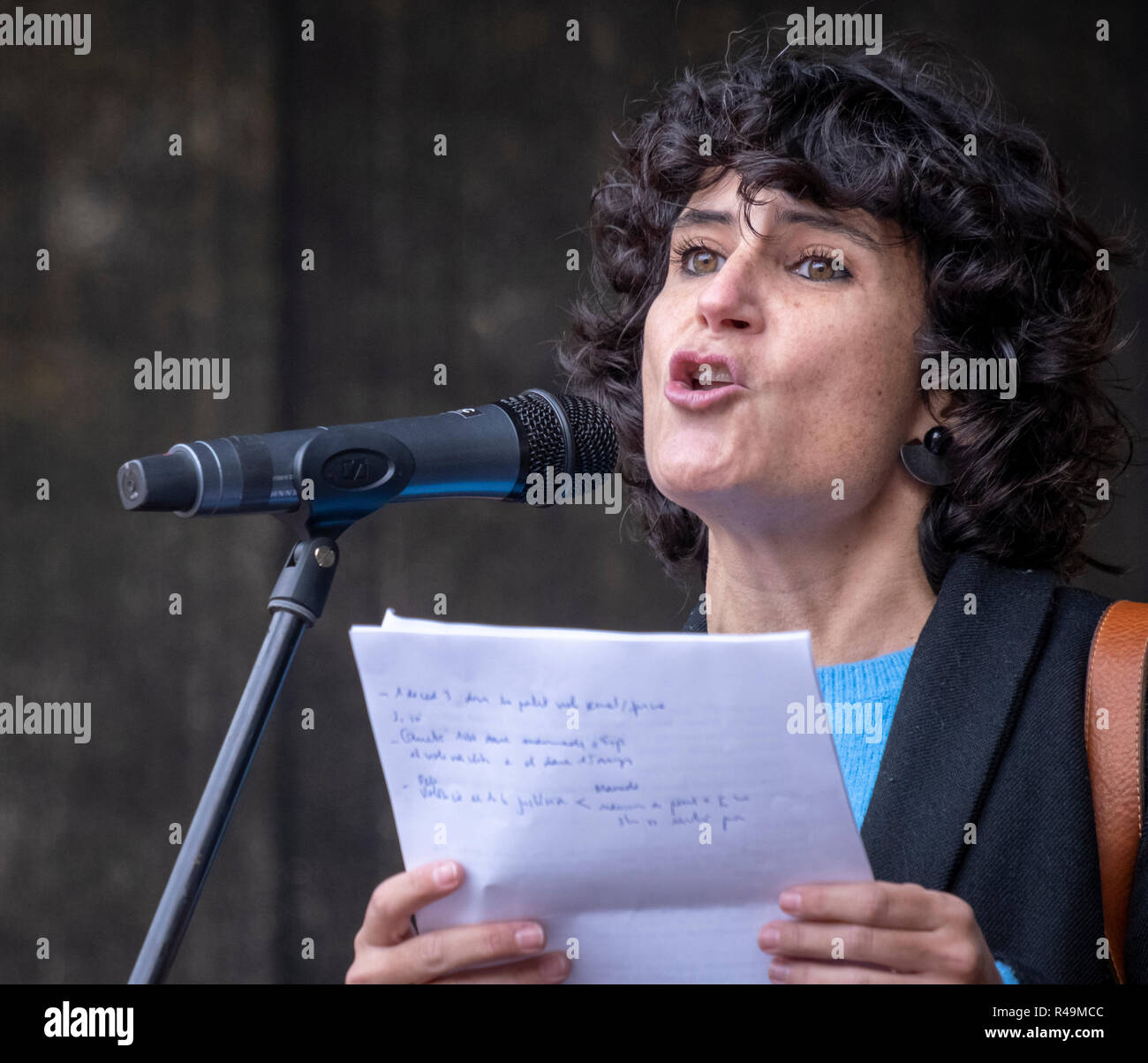 Cultural journalist Júlia Bertran is seen reading the manifesto of the demonstration during the protest. Thousands of people have taken to the streets in Barcelona on the occasion of the International Day for the Elimination of Violence against Women. - Stock Image