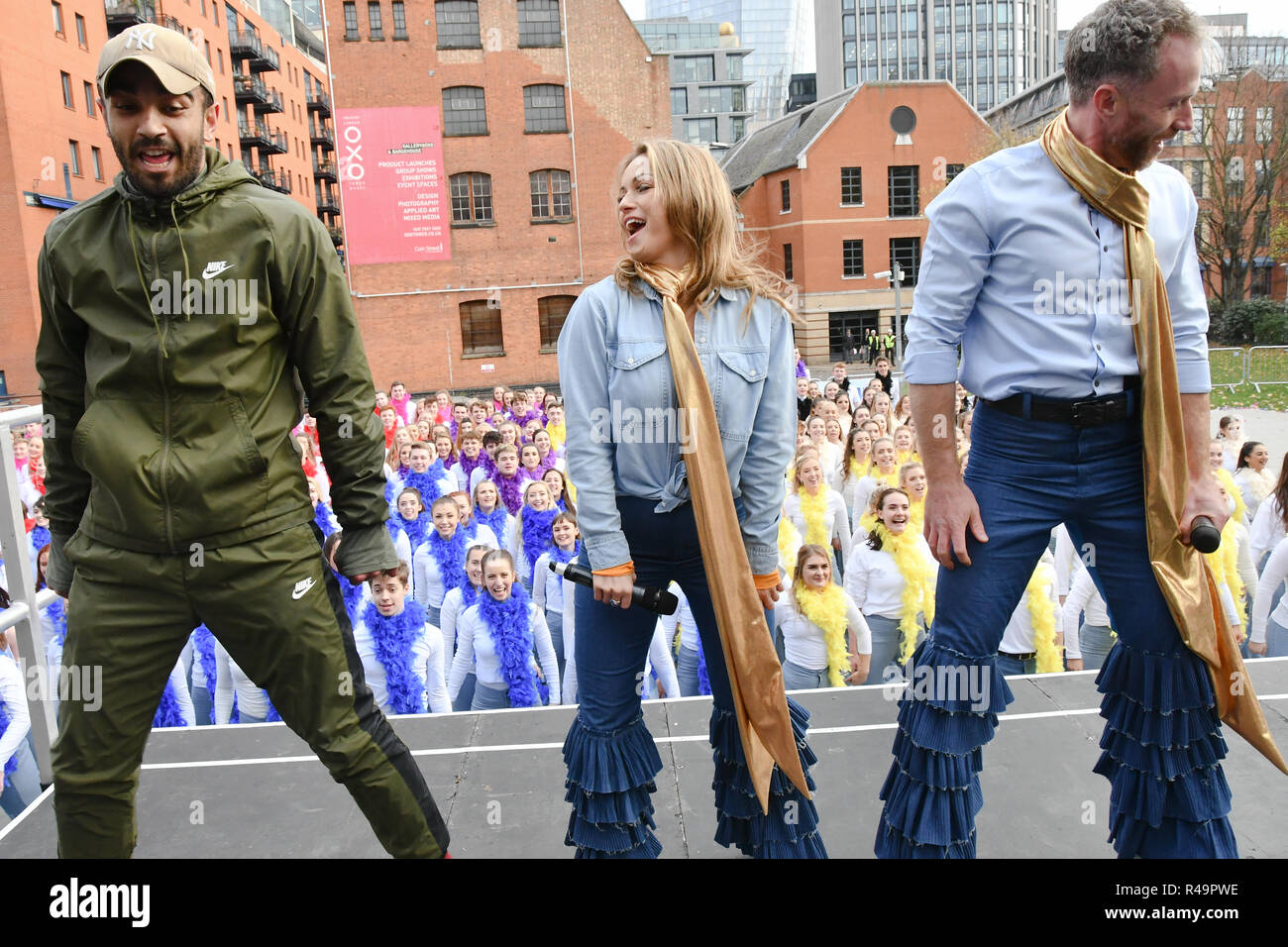 London, UK. 26th Nov, 2018. Strictly Come Dancing - James Jordan and Ola Jordan and Lucy Bardick is a Choreographer and casts Cassie Clare and Lukas Hunt join Mamma Mia! Here we go again hosts Guinness World Records largest disco dance at London Waterloo on 26 November 2018, London, UK Credit: Picture Capital/Alamy Live News - Stock Image
