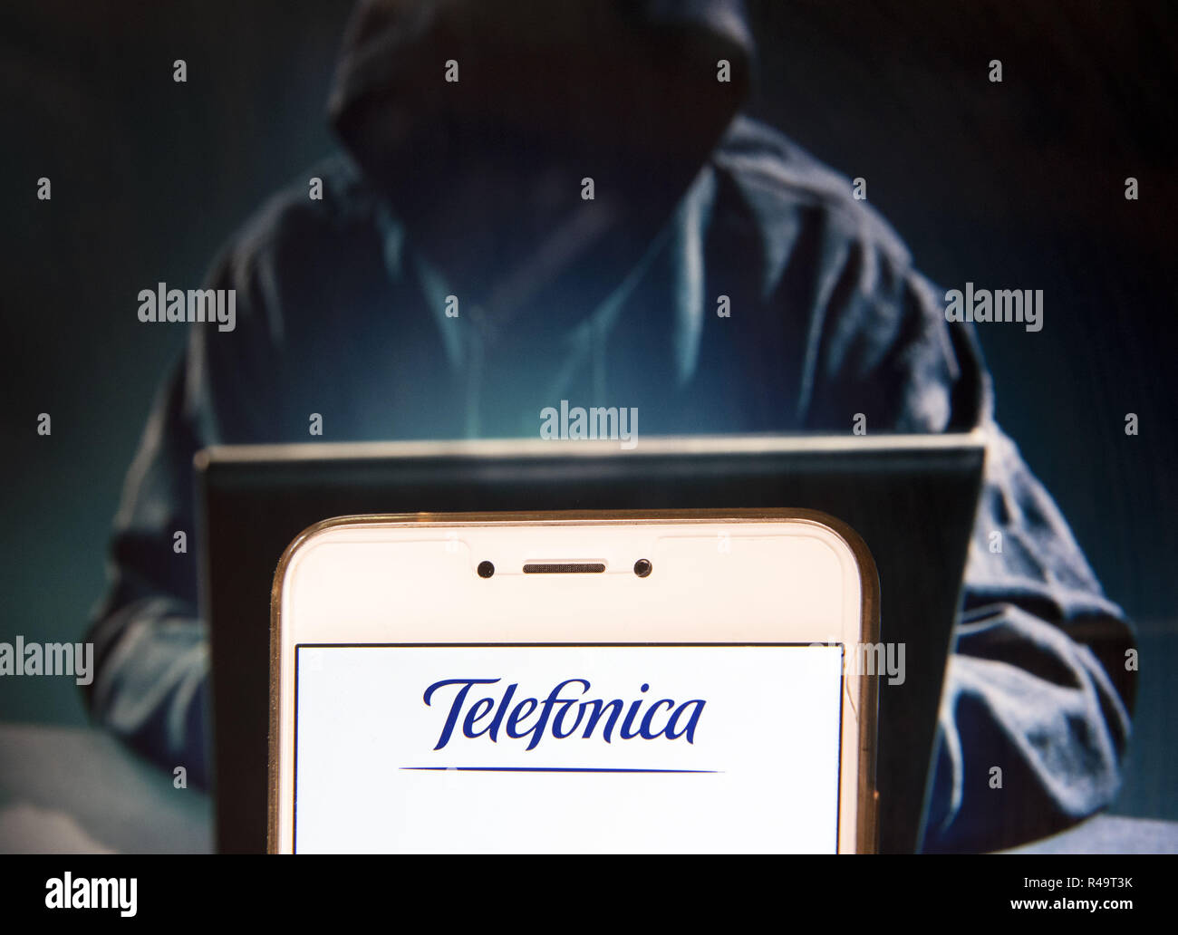 Hong Kong. 23rd Nov, 2018. Spanish multinational telecommunications company Telefonica logo is seen on an Android mobile device with a figure of hacker on the background. Credit: Miguel Candela/SOPA Images/ZUMA Wire/Alamy Live News - Stock Image
