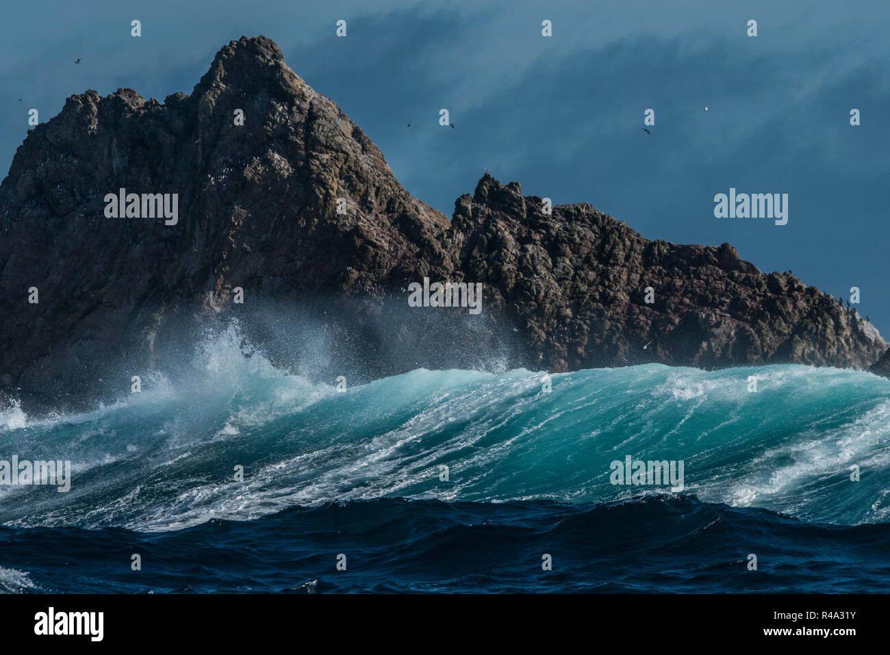 The Farallon islands jutting out of the pacific ocean as big waves roll in. Stock Photo