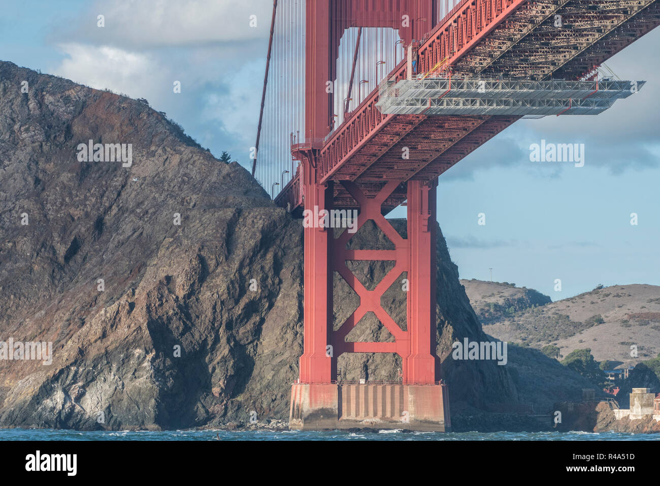 The famous golden gate bridge photographed from a different angle, from below in the San Francisco Bay from within a boat. - Stock Image