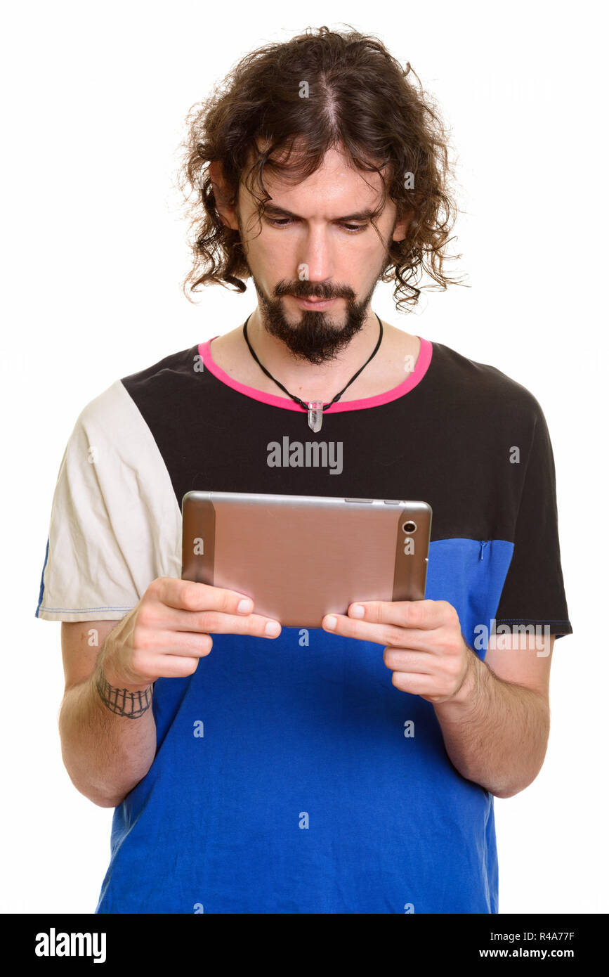 Handsome Caucasian man holding digital tablet - Stock Image