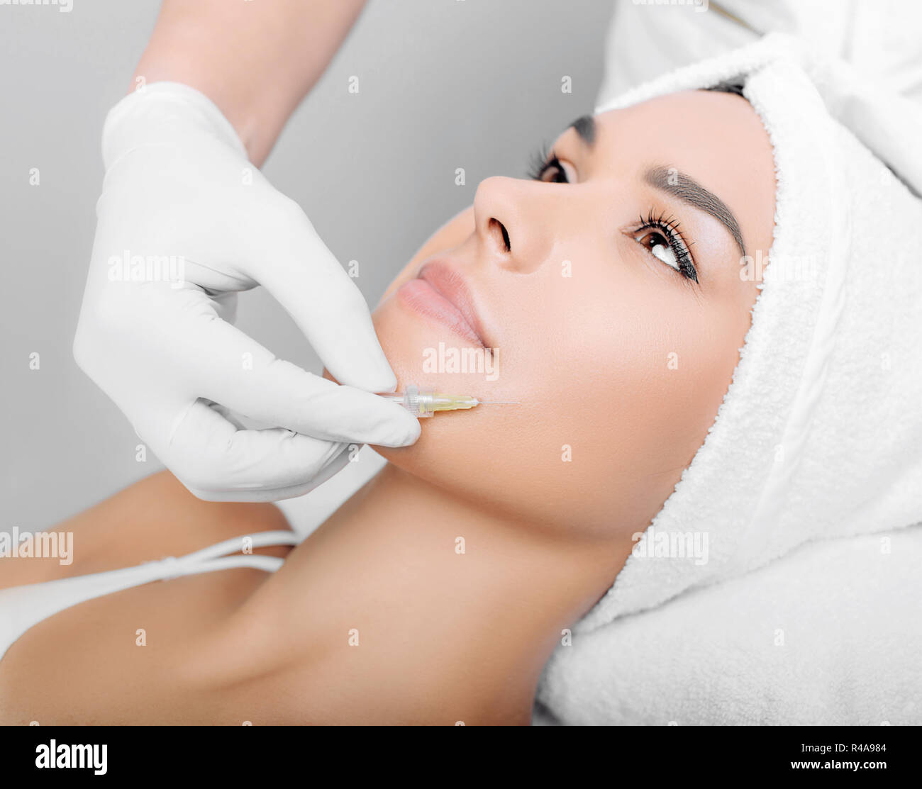 woman having facial injections for facelift and anti-aging effect Stock Photo
