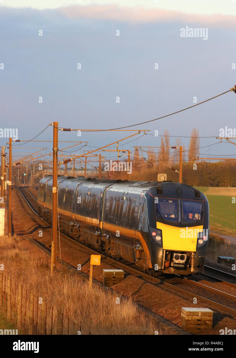 Class 180 diesel-hydraulic multiple unit train in Grand Central livery on East Coast Main Line near Colton junction, south of York, 24th November 2018. - Stock Image
