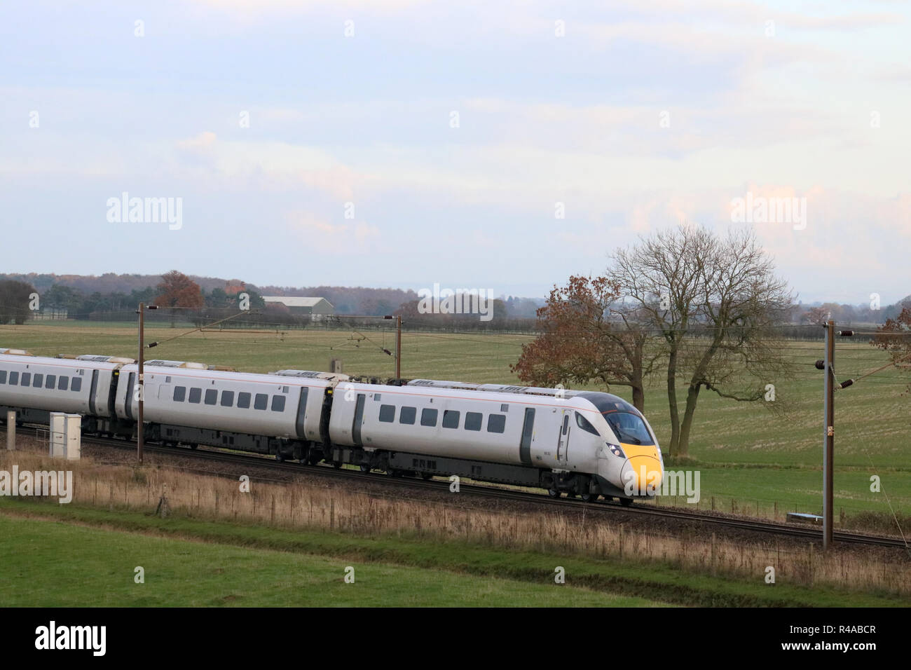 New class 800 bi-mode multiple unit train on empty coaching stock movement just south of Colton junction on east Coast Main Line south of York in 2018. - Stock Image