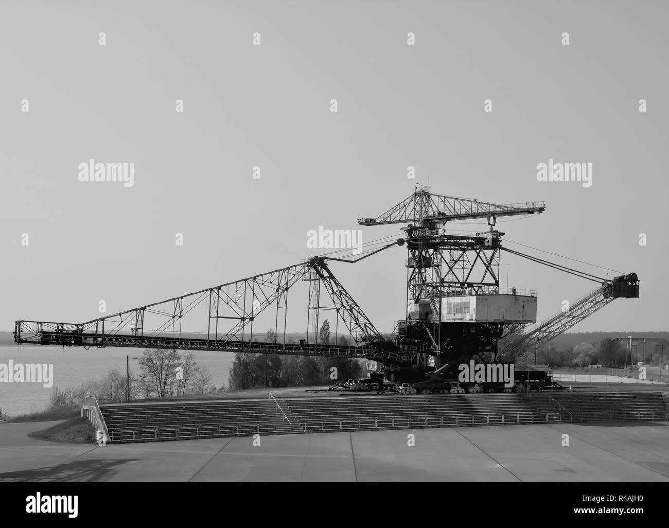 discarded lignite excavator in the disused opencast mine Ferropolis Stock Photo