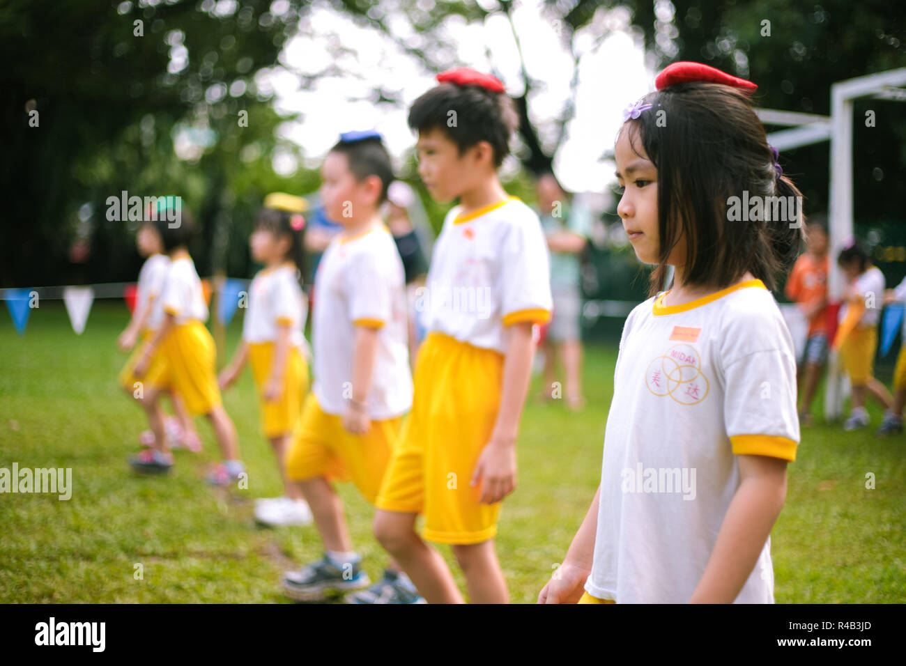 Children ready to play bean bag competition during their kindergarten sports day - Stock Image