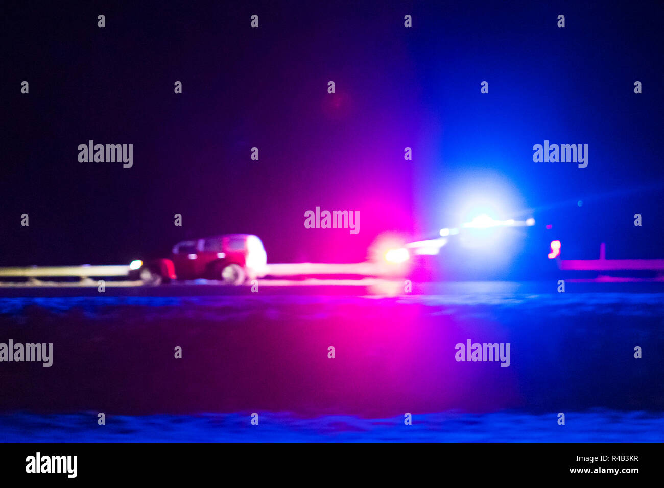 Police officer car catching a car with over speed limit at night time.  blurred. Stock Photo