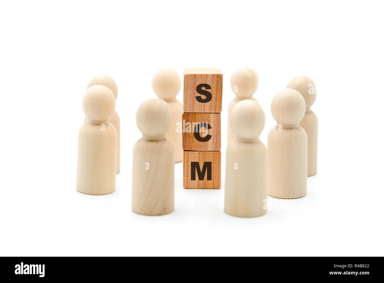 Wooden figures as business team in circle around acronym SCM Supply Chain Management, isolated on white background, minimalist concept Stock Photo