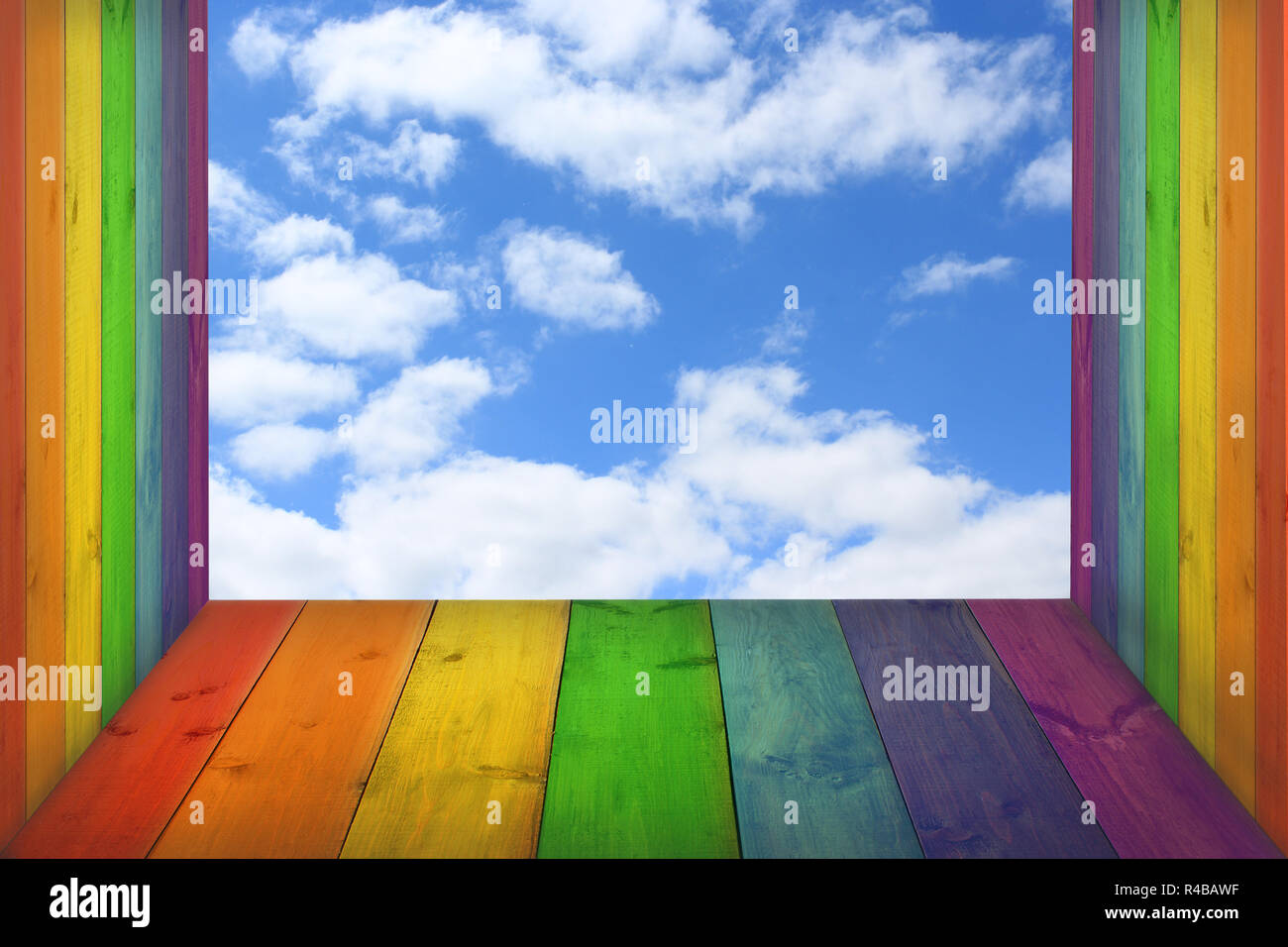 view to the sky from boards in colors of rainbow Stock Photo